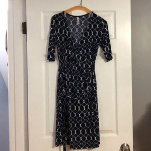 Navy blue and white wrap dress